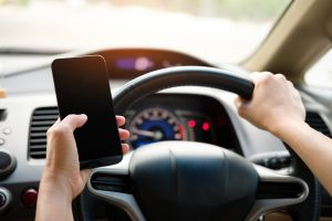 Drivers to face prosecution for touching mobile phone while driving