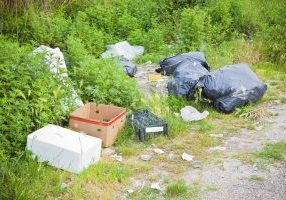 image of rubbish dumped in country lane