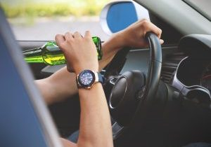 person-driving-and-drinking-174936