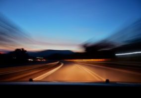 image of blurred road from car